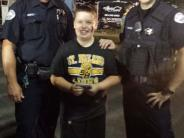Photo of Officers Howell and Ward with an autograph contest participant