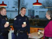 Photo of Officers Thompson and Howell at a Coffee with a Cop event