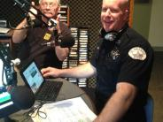 Photo of Chief Terry Moss participating in Cop Talk on KOHI 1600 AM