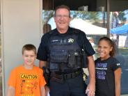Photo of Lieutenant Graham with two children