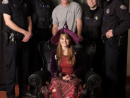 Photo of police staff with Kimberly Brown of Halloweentown.