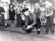 Archive photo of a St Helens Officer showing school children the beaver that was used to dam up Milton Creek